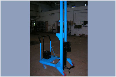 Drum Stacker With Auto Gripper